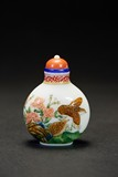 AN ENAMELLED 'FLOWERS AND BIRDS' GLASS SNUFF BOTTLE