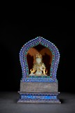 A WHITE JADE BODHISATTVA WITH SILVER GEMS INLAID SHRINE