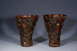 A PAIR OF AGARWOOD CARVED LIBATION CUPS