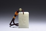 A WHITE JADE RECTANGULAR 'POEM AND FIGURES' PENDANT