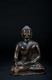 A BRONZE STATUE OF A SEATED BUDDHA