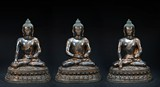 A SET OF THREE LARGE BRONZE STATUES OF SEATED BUDDHA