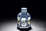 A BLUE AND WHITE 'FIGURES' JAR