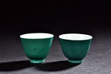 A PAIR OF GREEN GLAZED CUPS