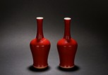 A PAIR OF RED GLAZED 'MALLET' VASES