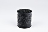 A BLACK JADE OR STONE COVERED BRUSHPOT