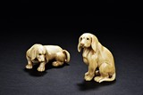 A PAIR OF TWO BONE CARVED EUROPEAN DOGS