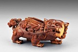 AN BONE CARVED BUDDHIST LION