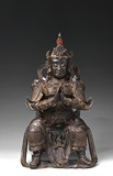 A LARGE PARCEL-GILT BRONZE CAST WEITUO STATUE