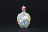AN ENAMELED 'FIGURE' COPPER SNUFF BOTTLE