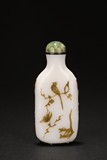 A BLACK OVERLAY 'FLOWER AND BIRD' ON WHITE GLASS SNUFF BOTTLE