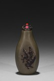 A CARVED 'PLUM BRANCHES' SNUFF BOTTLE