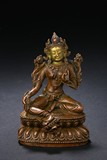 A GILT PAINTED BRONZE TARA