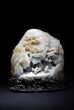 A WHITE JADE CARVED 'FIGURES' MOUNTAIN BOULDER