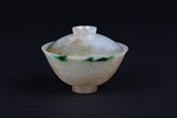 A NATURAL JADEITE BOWL WITH COVER