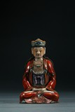 A FAMILLE ROSE FIGURE OF SEATED GUANYIN