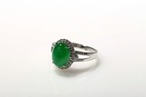 A BRIGHT APPLE GREEN JADEITE RING