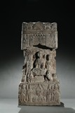 A FOUR-SIDED STONE CARVED BUDDHIST STELE