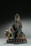 A BRONZE PAINTED FIGURE OF MANJUSRI ON LION