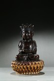 AN AGARWOOD CARVED FIGURE OF BODHISATTVA