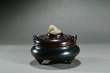 A BRONZE TRIPOD CENSER WITH WHITE JADE LION FINIAL COVER