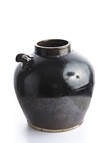 A BLACK GLAZED EWER