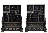 A PAIR OF GILT-PAINTED BLACK LACQUER TABLE SCREEN CABINETS