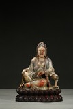 A PAINTED SHOUSHAN CARVING OF GUANYIN