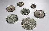 A GROUP OF SEVEN ARCHAIC BRONZE MIRRORS
