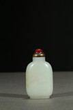 A WHITE JADE CARVED SNUFF BOTTLE