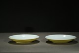 A PAIR OF YELLOW GLAZED INCISED DISHES