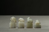 A GROUP OF JADE CARVED MYTHICAL LION SEALS