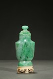 A JADEITE CARVED VASE WITH BONE STAND