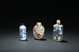 A SET OF THREE CERAMIC SNUFF BOTTLES