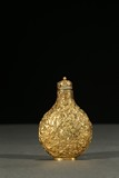 A GILT-BRONZE 'FLORAL SCROLLS' SNUFF BOTTLE