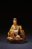 A SHOUSHAN SOAPSTONE SEATED GUANYIN