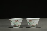 A PAIR OF FAMILLE ROSE 'PEONY' CUPS