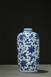A BLUE AND WHITE CYLINDRICAL 'LOTUS' TEA CADDY
