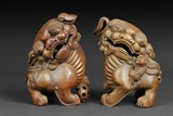 A PAIR OF BAMBOO ROOT BUDDHIST LIONS CARVINGS