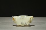A WHITE JADE 'INSCRIPTION' TRIPOD CENSER