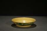A YELLOW GROUND GREEN 'DRAGON' DISH