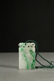 A JADEITE CARVED 'CRANE AND PINE' PENDANT