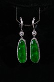 A PAIR OF JADEITE AND DIAMOND PENDANTS
