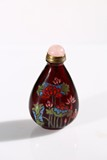 A GLASS 'LOTUS' SNUFF BOTTLE