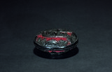A CINNABAR LACQUER FIGURES PASTE BOX