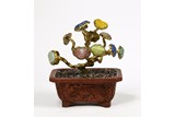 A CINNABAR LACQUER GILT-BRONZE GEMS INLAID PLANTER