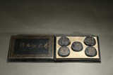 SET OF FIVE GILT INSCRIBED BARREL-FORM INKCAKES