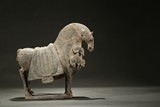 A LIMESTONE CARVED HORSE