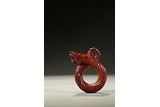 A RED JADE KNOTTED DRAGON PENDANT