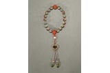 A CORAL AND PEARL JADEITE ROSARY BRACELET